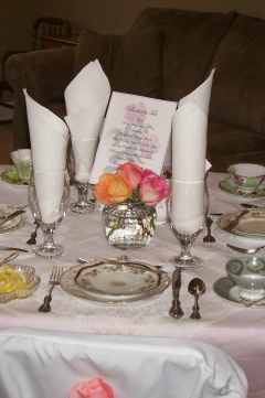 Every table set with beautiful antique linens and china